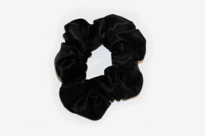 Black Colored Silk Scrunchie Displayed On A White Background