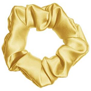 Gold Colored Silk Scrunchie Displayed On A White Background